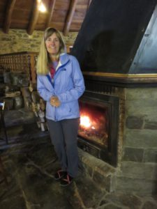 Laurie in her favorite spot--next to the fire