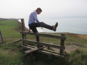 Laurie negotiating a stile to cross a fence